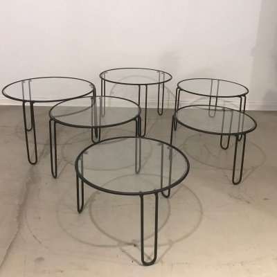 Set of 6 round glass coffee tables (3 sizes) with black metal structure, 1970s