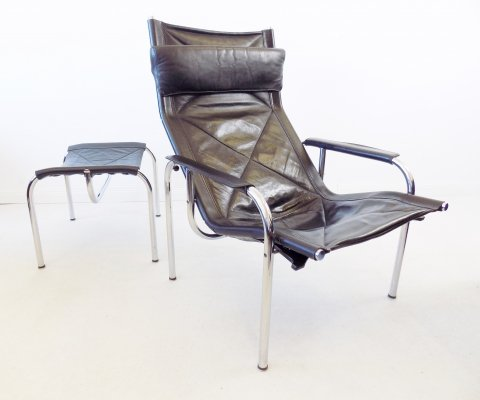 Strässle HE1106 black leather lounge chair with ottoman by Hans Eichenberger