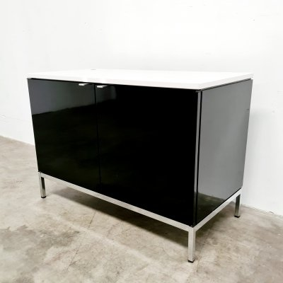 Knoll cabinet in black lacquered wood & white stone top, 1970s