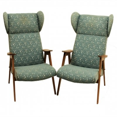 Set of two lounge chairs with wooden armrests