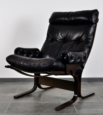 Easy chair in black leather & teak by Ingmar Relling for Westnova, 1980s