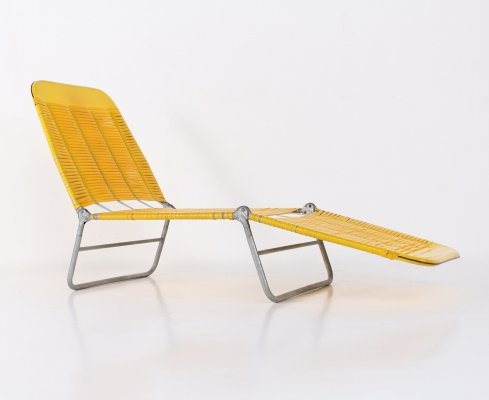 Yellow woven plastic lounge chair, 1960's