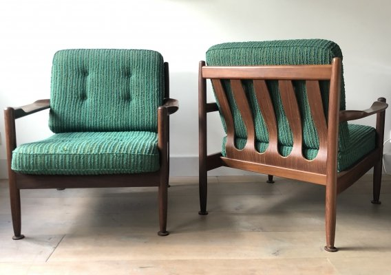 Matching pair of Danish easy chairs in rosewood by Grete Jalk, 1960s