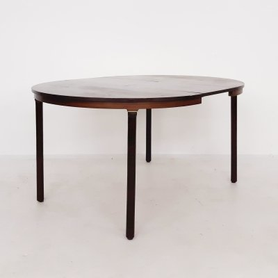 Round rosewood extendable dining table by Fristho, The Netherlands 1960's