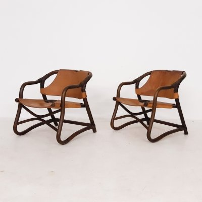 Set of two mid-century manou & leather lounge chairs