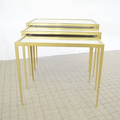 Brass nesting tables with mirrored glass by Vereinigte Werkstätten Münich, 1950s