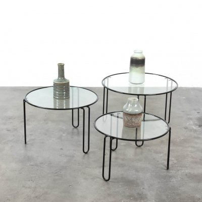 Set of three nest-tables made of black iron frame with glass top