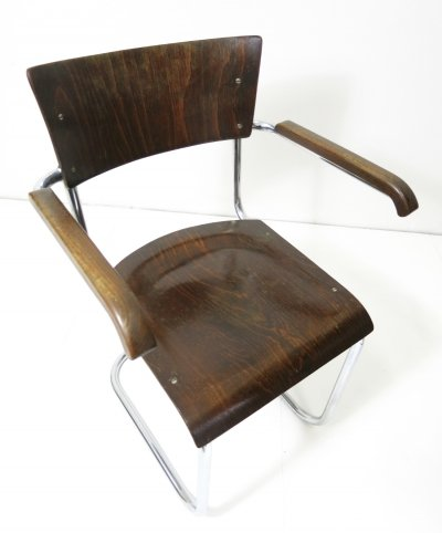 Tubular steel cantilever chair with armrests by Mart Stam