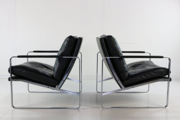 Pair of Black leather lounge chairs by Preben Fabricius
