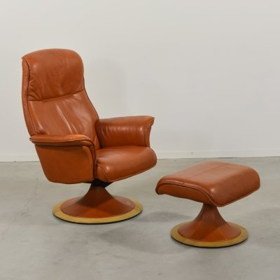 'Berg furniture' lounge chair with ottoman in cognac leather
