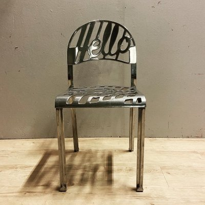 Vintage shiny aluminium hello there chair by Jeremy Harvey for Artifort