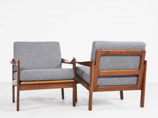 Midcentury Danish pair of easy chairs in teak by Illum Wikkelsø for Eilersen