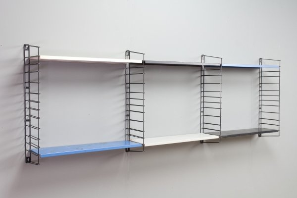 Modular Tomado metal wall unit in blue, white, grey & black
