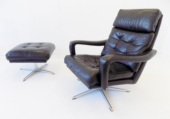 Danish black leather armchair with ottoman, 1970s