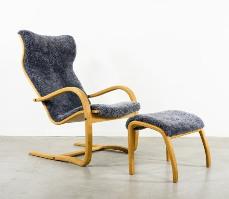 Danish Modern Sculptural lounge armchair with ottoman, 1980s