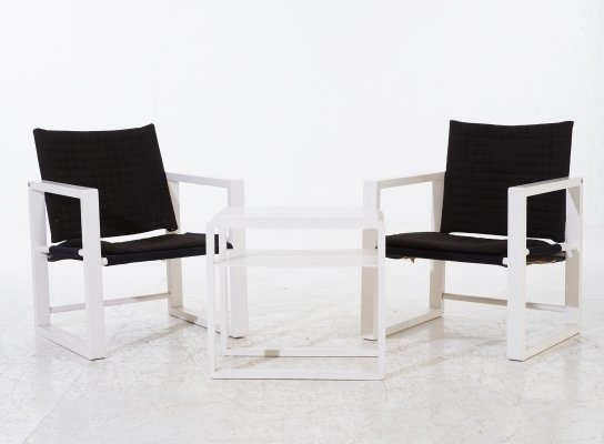 Set of two 'Safari' armchairs with a side table from Nordiska Kompaniet, 1960's