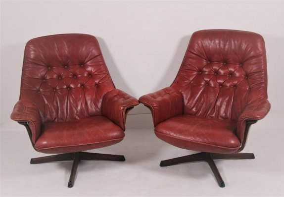 Pair of Vintage red leather swivel armchairs with wooden accents, 1960s