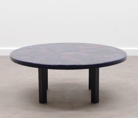 Coffee table with one piece ceramic top & black metal frame