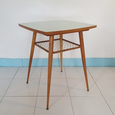 Mid century table with rotating pale blue Formica Top