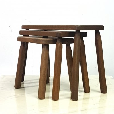 Set of three brutalist solid oak nesting tables, 1960s
