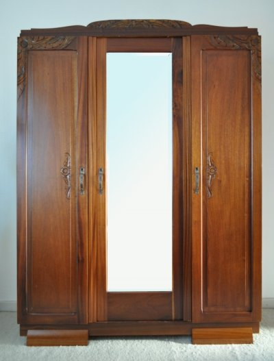 French Art Deco three-door cabinet in solid mahogany with faceted mirror