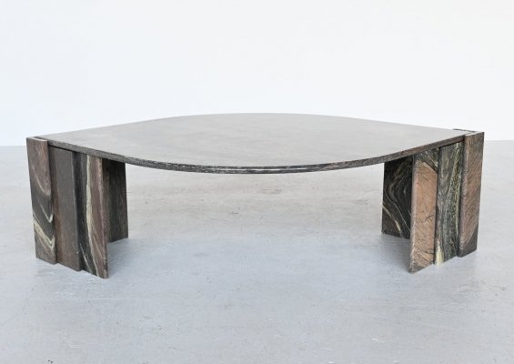 Sculptural eye shaped dark marble coffee table, Italy 1970