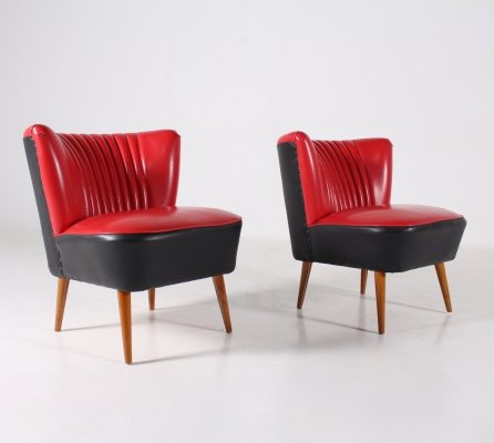 Pair of red & black faux-leather cocktail armchairs, 1960's