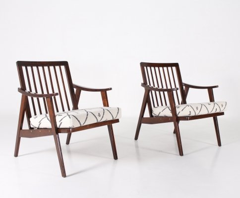 Pair of modernist 'visitor' beech armchairs with compass feet, 1960's