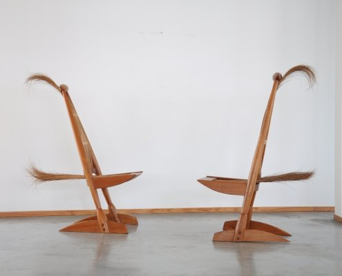 1970s pair of Italian Sculptural side chairs in tropical wood & rattan
