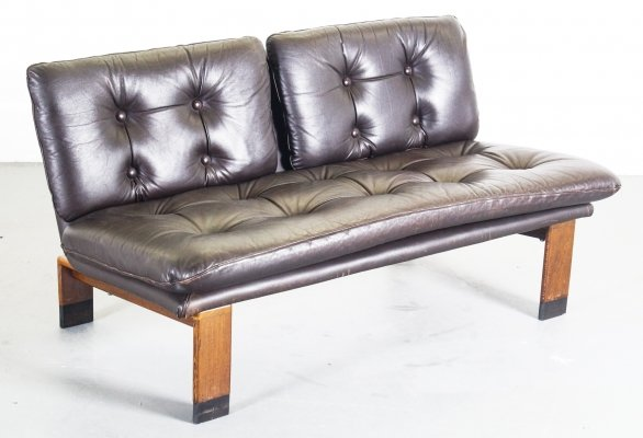 Leather buttoned two-seater on teak frame