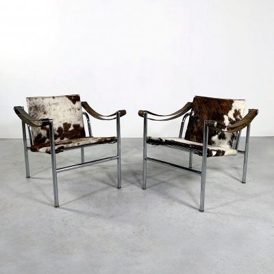 Pair of Cow Hide LC1 Armchairs by Le Corbusier for Cassina, 1970s