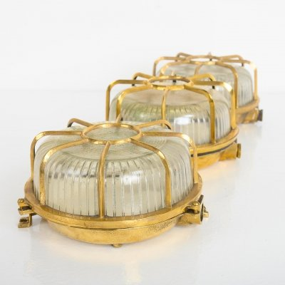 Circular brass ship bulkhead lights with prismatic glass, 1940s