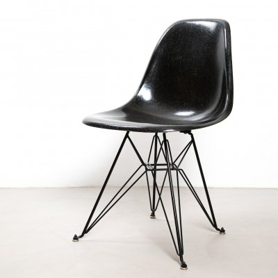 Eames fiberglass shell side chair by Herman Miller