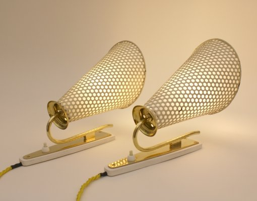 Pair of perforated metal wall lamps, Switzerland 1950s