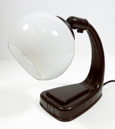 Small bakelite lamp in dark brown with a white opaline glass shade