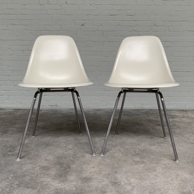 Pair of fiberglass DSX chairs by Charles & Ray Eames for Herman Miller, 1970s