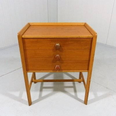 Small teak chest of drawers / side table with leather handles