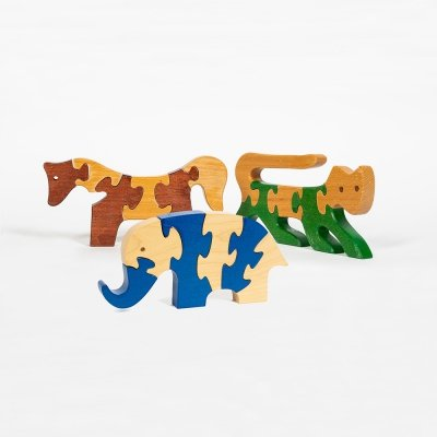 Three solid wood puzzles designed by Antonio Vitali