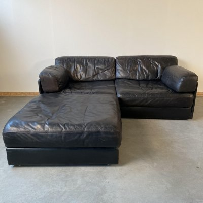 Black leather DS 76 2-seater sofa & ottoman by De Sede, 1970s