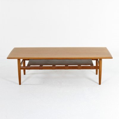 Teak coffee table with leather magazine rack, Denmark 1971