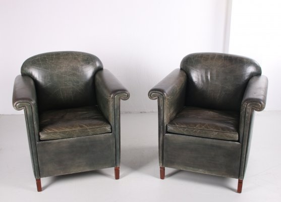 Set of two old green leather armchairs, 1970s