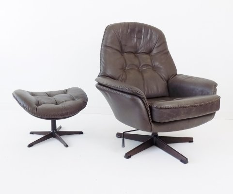 Danish leather armchair in gray with ottoman, 60s