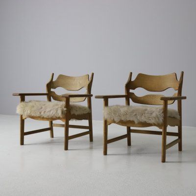 Pair of Henning Kjaernulf razor blade chairs in patinated oak & sheepskin, 1960s