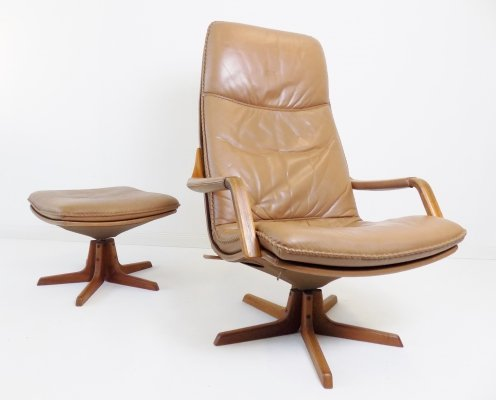 Berg Furnitures cognac-colored leather armchair with ottoman