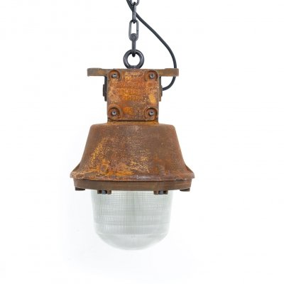 Rusted explosionproof industrial pendant lights by Holophane