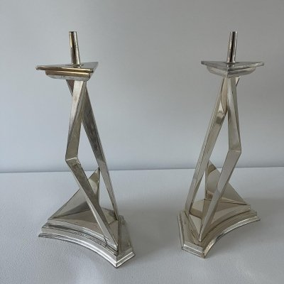 Pair of Salvador Dali chromium plated metal pricket candlesticks: L'immortaliti de Castor et Pollux