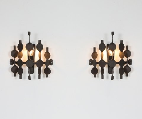 Pair of Brutalist forged iron wall sconces by Atelier Français, 1970's