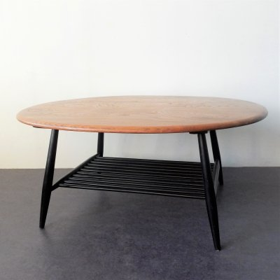Wooden top 'model 454' coffee table with black frame by Lucian Ercolani for Ercol