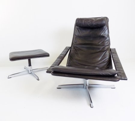 Goldsiegel brown leather armchair with ottoman, 1960s