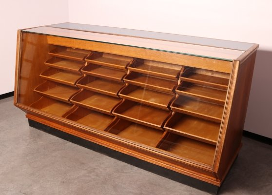 Large diamond shaped shop counter with 24 drawers & bins, 1950's
